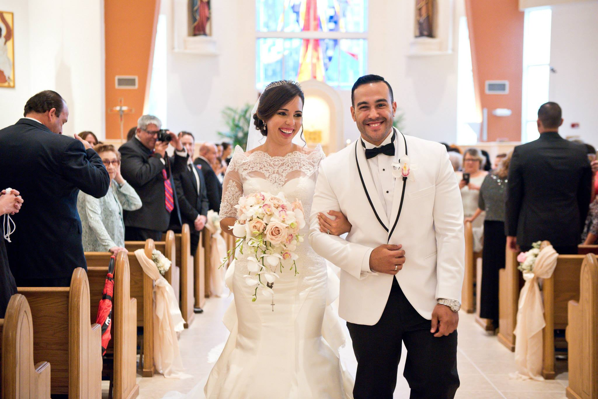 bride and groom walking down the aisle wedding bouquet