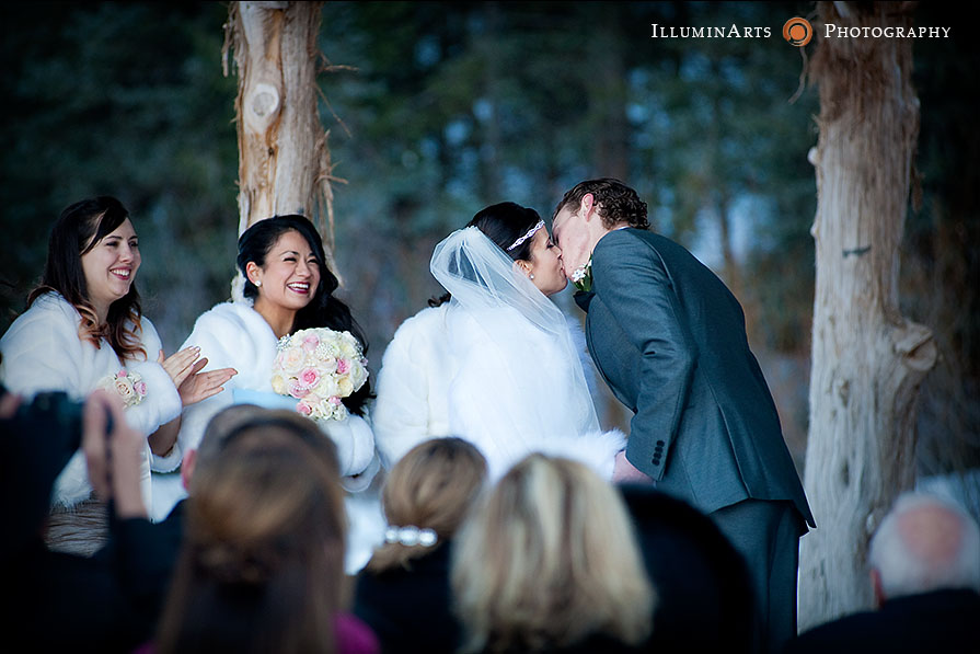 bride and groom first kiss as husband and wife
