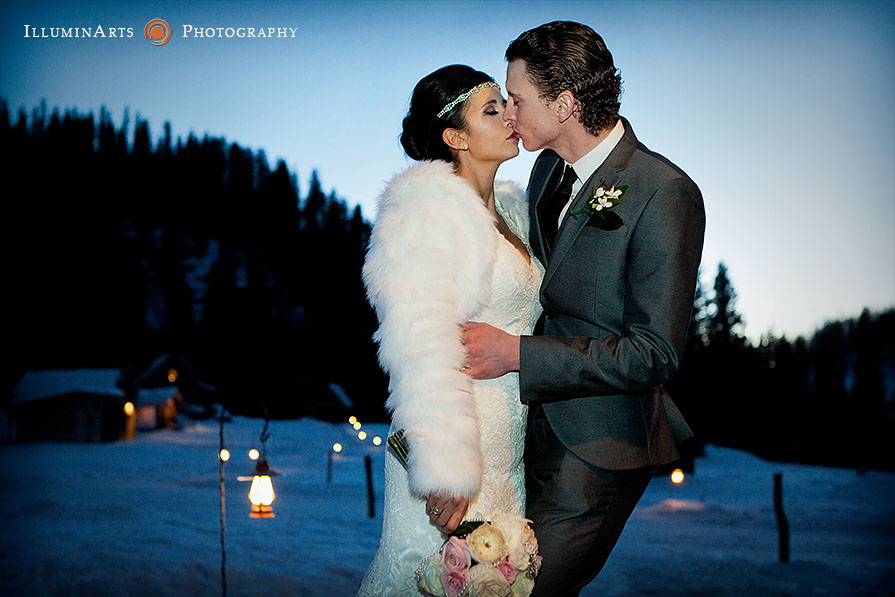 bride and groom kiss winter wedding