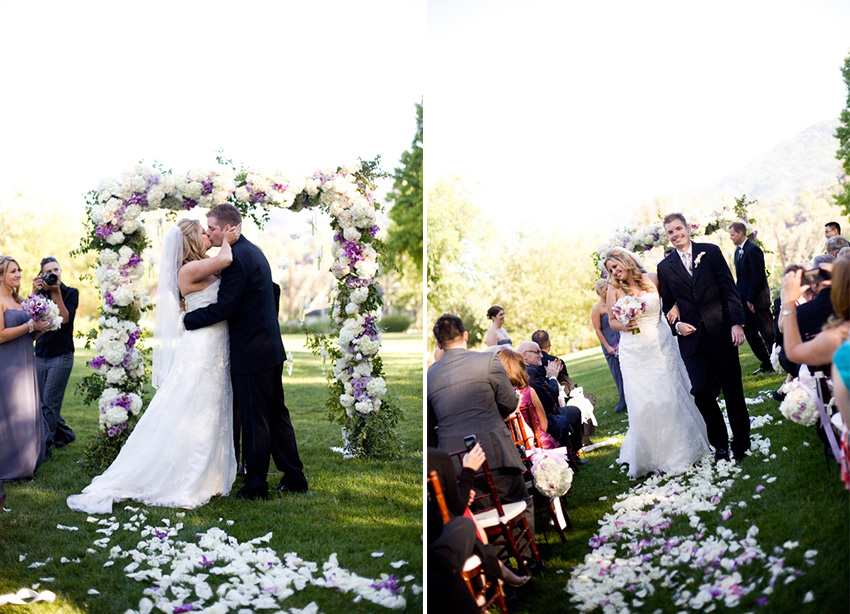bride and groom just married first kiss