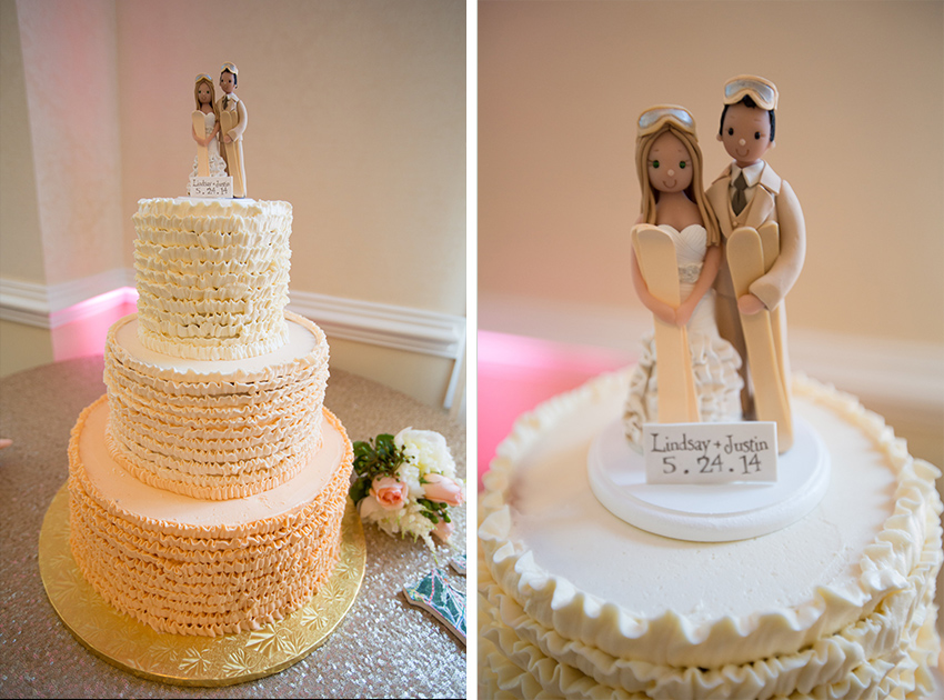 ombre wedding cake with couple and skis topper