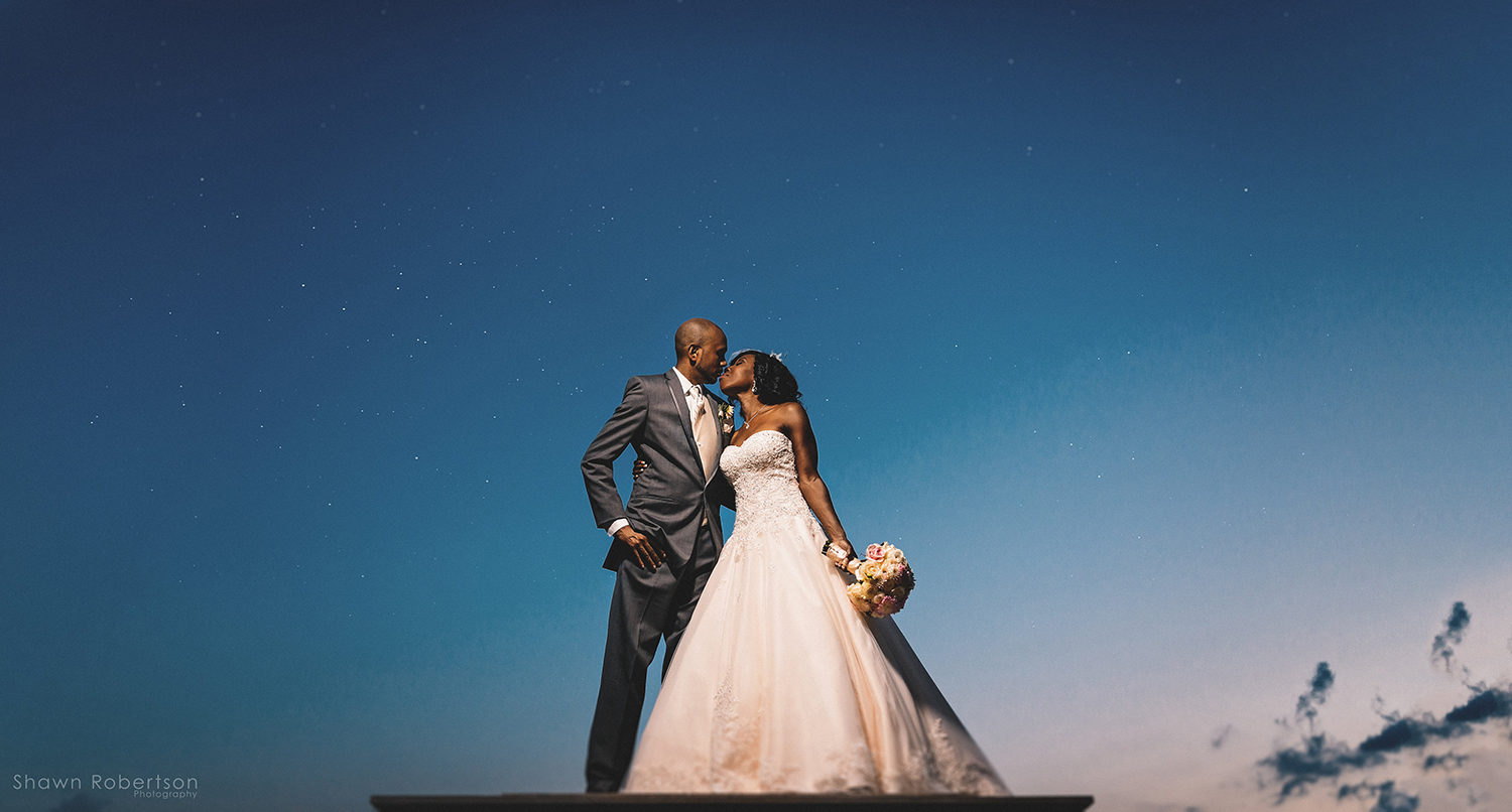 bride and groom kiss rooftop wedding