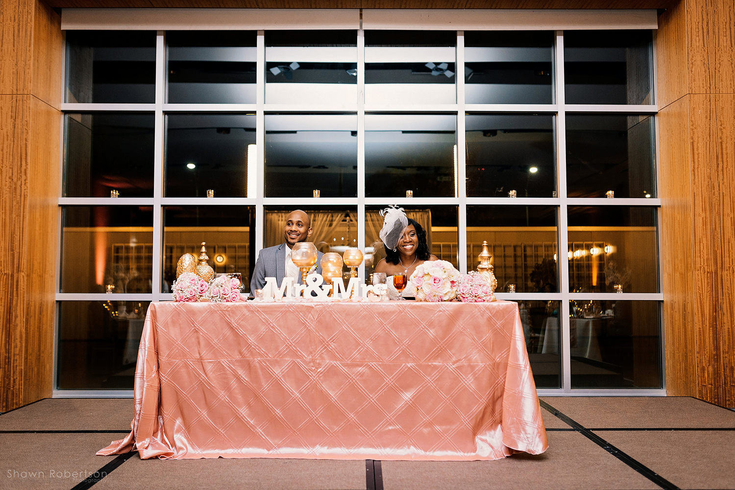 bride and groom at blush pink and gold wedding reception