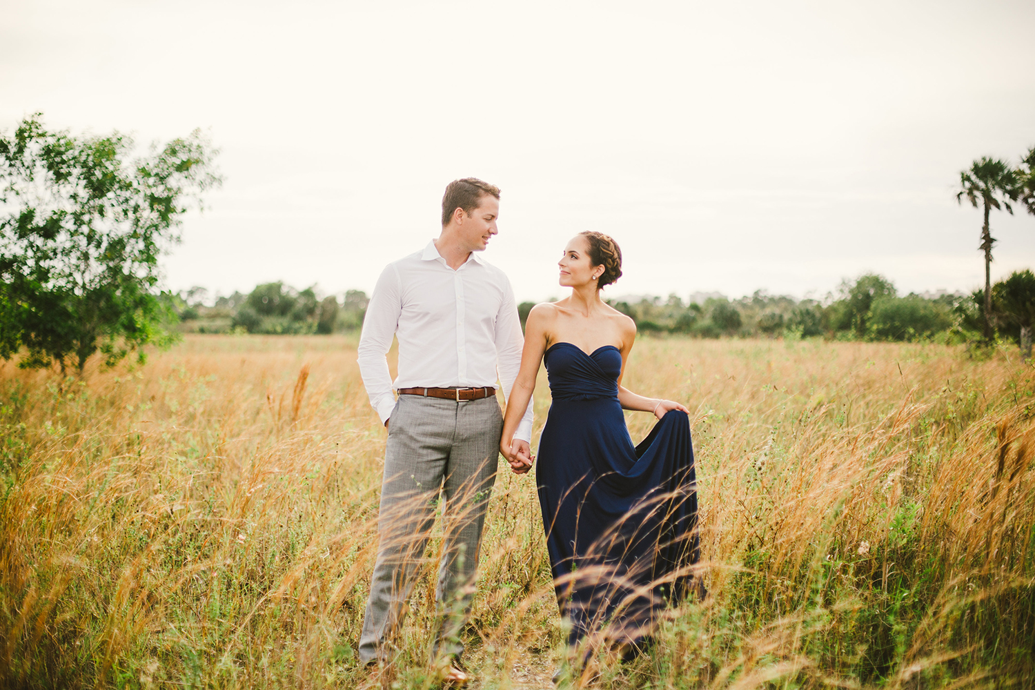romantic engagement shoot in a field in florida