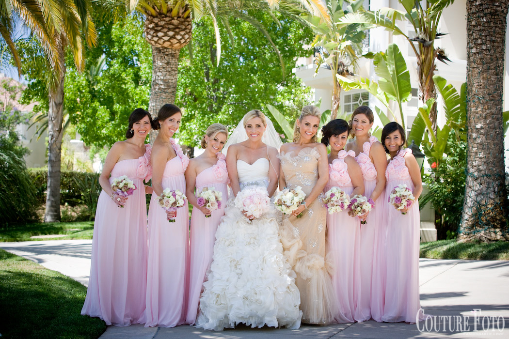 bride with bridesmaids in blush dresses