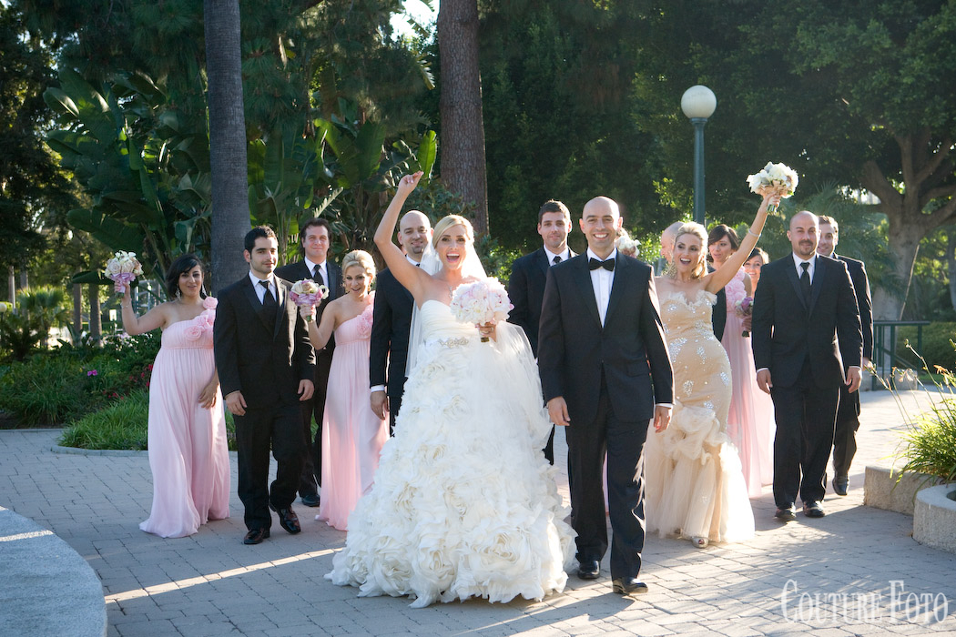 bride, groom, and bridal party on day of wedding