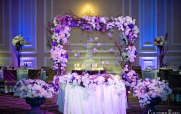 custom made floral canopy with branches adorning the sweetheart table
