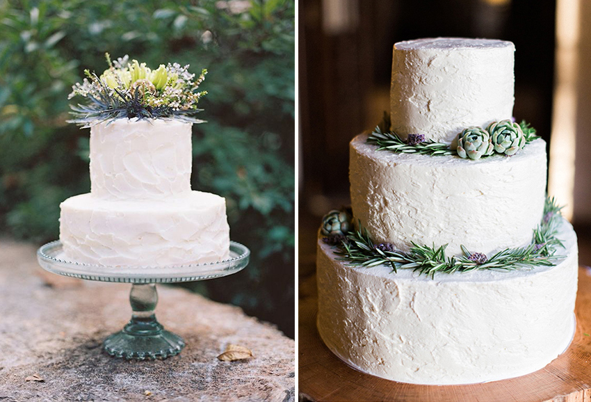 white buttercream wedding cake with greenery and foliage