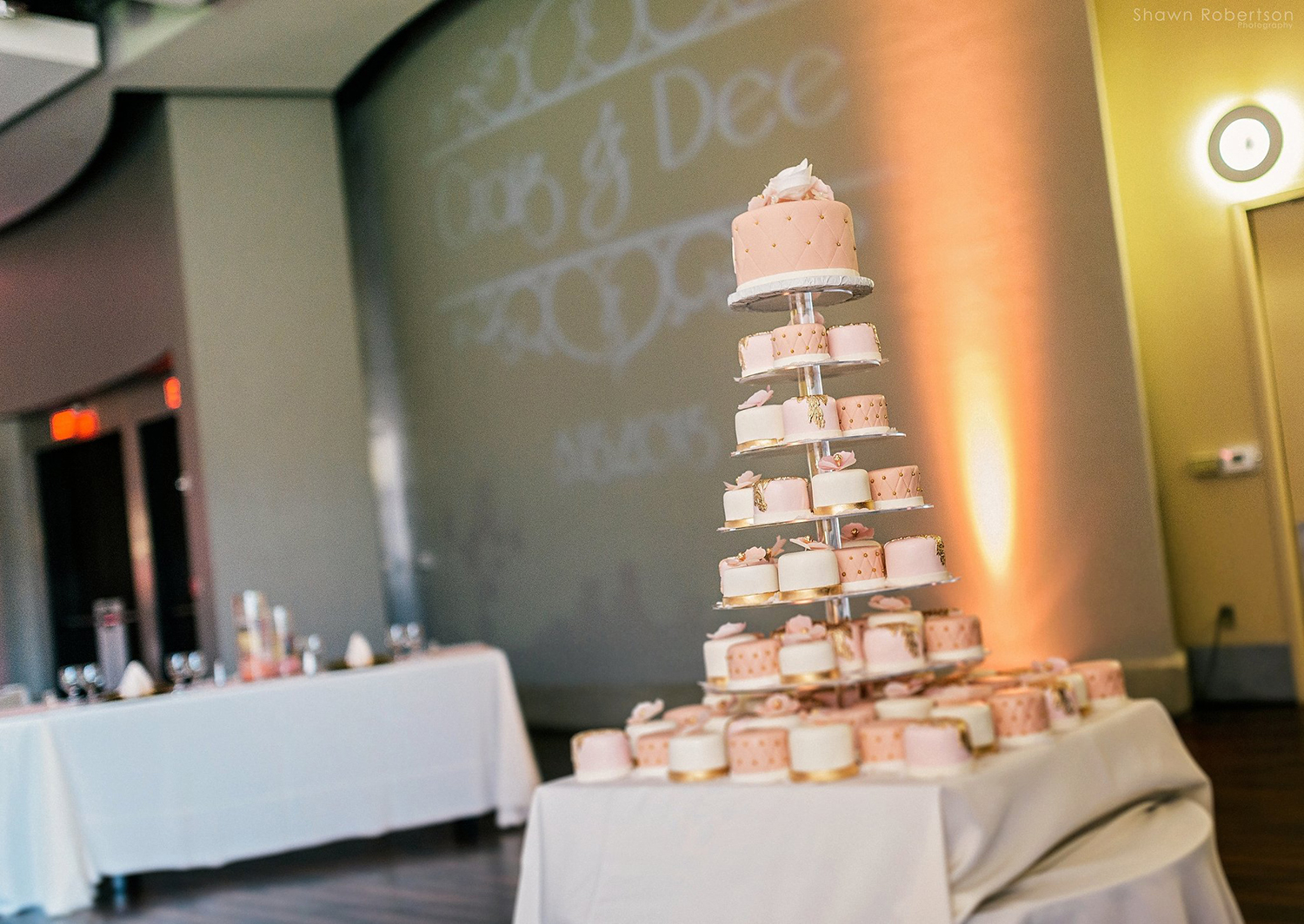 wedding cake alternative: tower of treats with mini cakes and cupcakes
