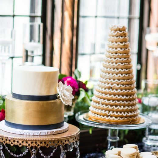 metallic gold wedding cake and tower of treats