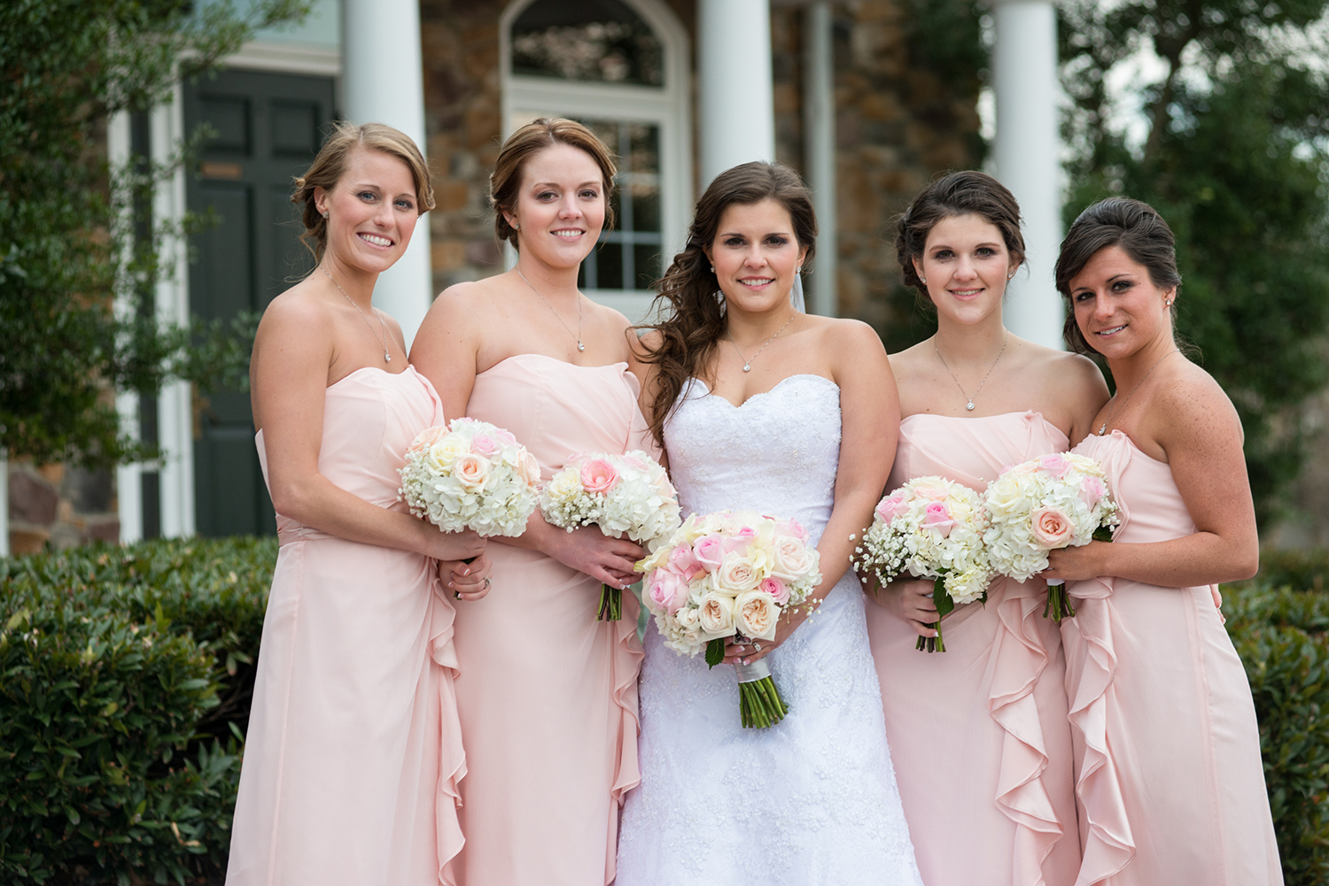 bride and bridesmaids in blush pink dresses