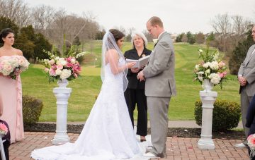 bride and groom getting married in outdoor wedding ceremony in virginia