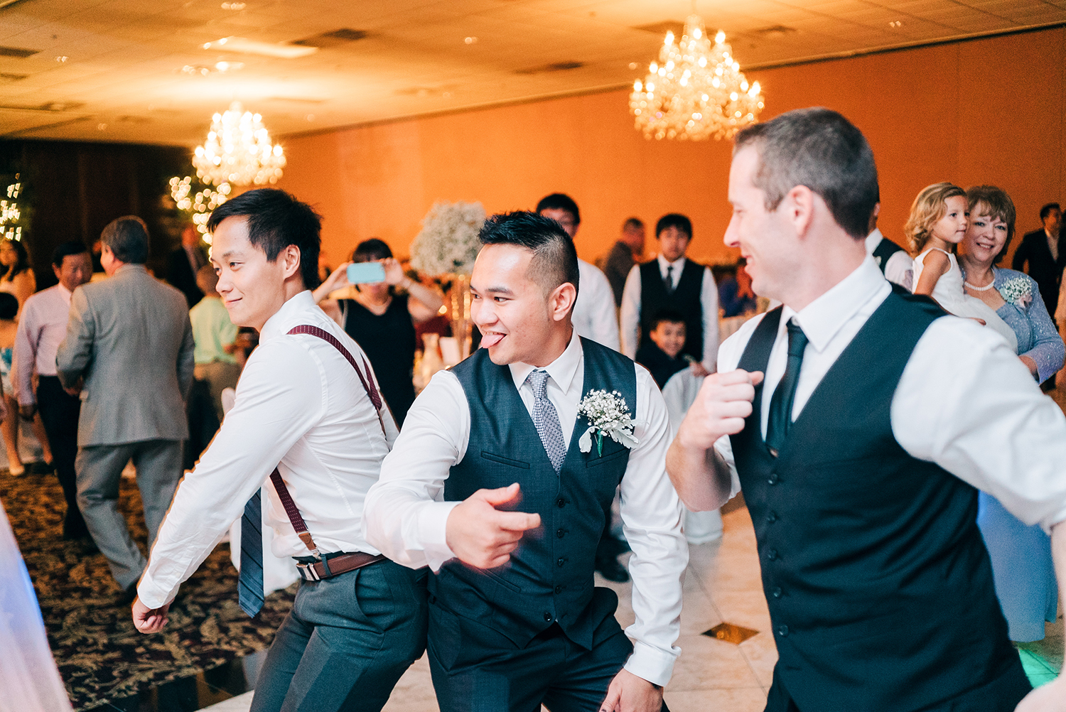 groom and groomsmen dancing at wedding reception