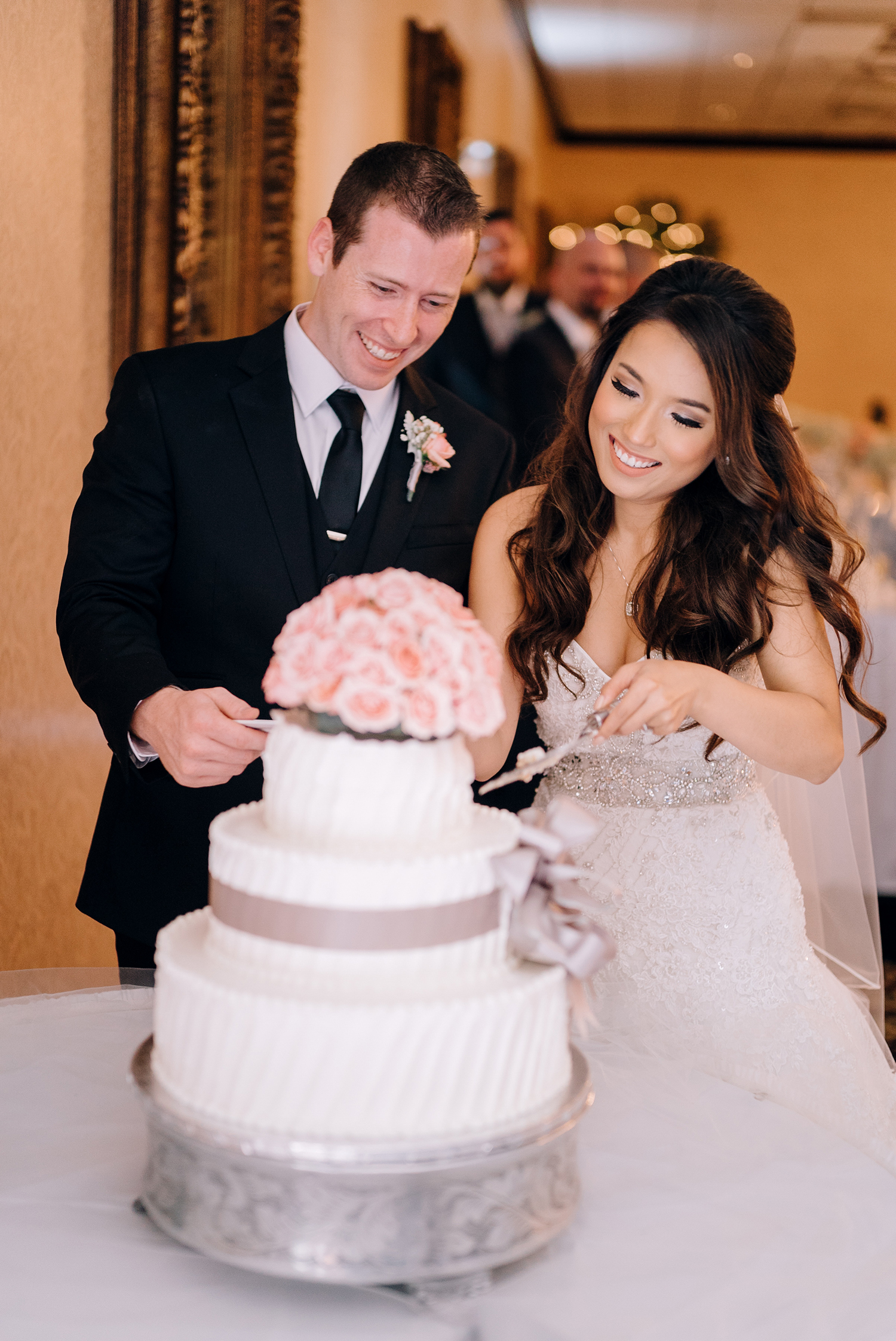 bride and groom cutting cake at classic romance wedding
