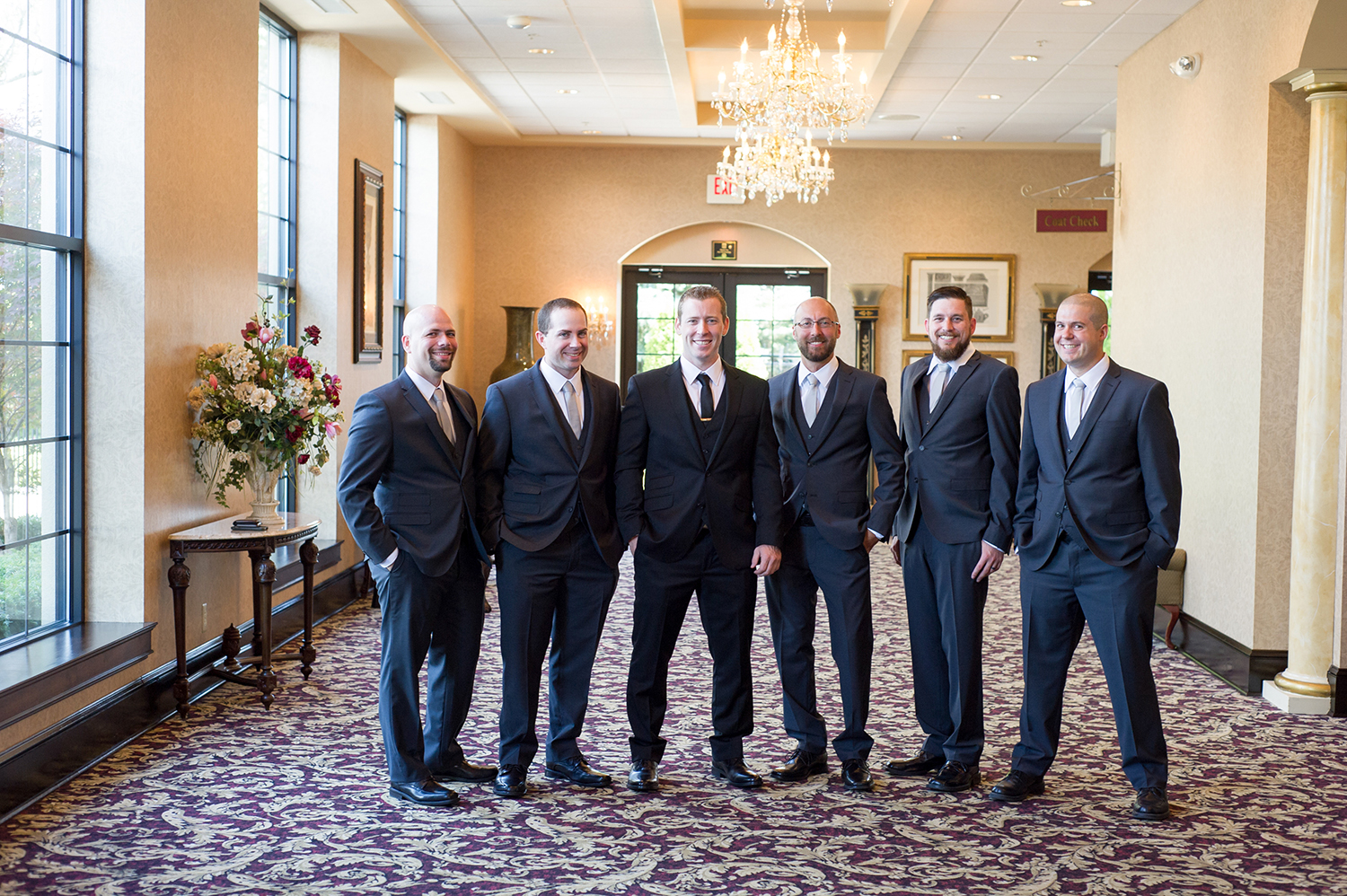 groom and groomsmen before nature filled wedding