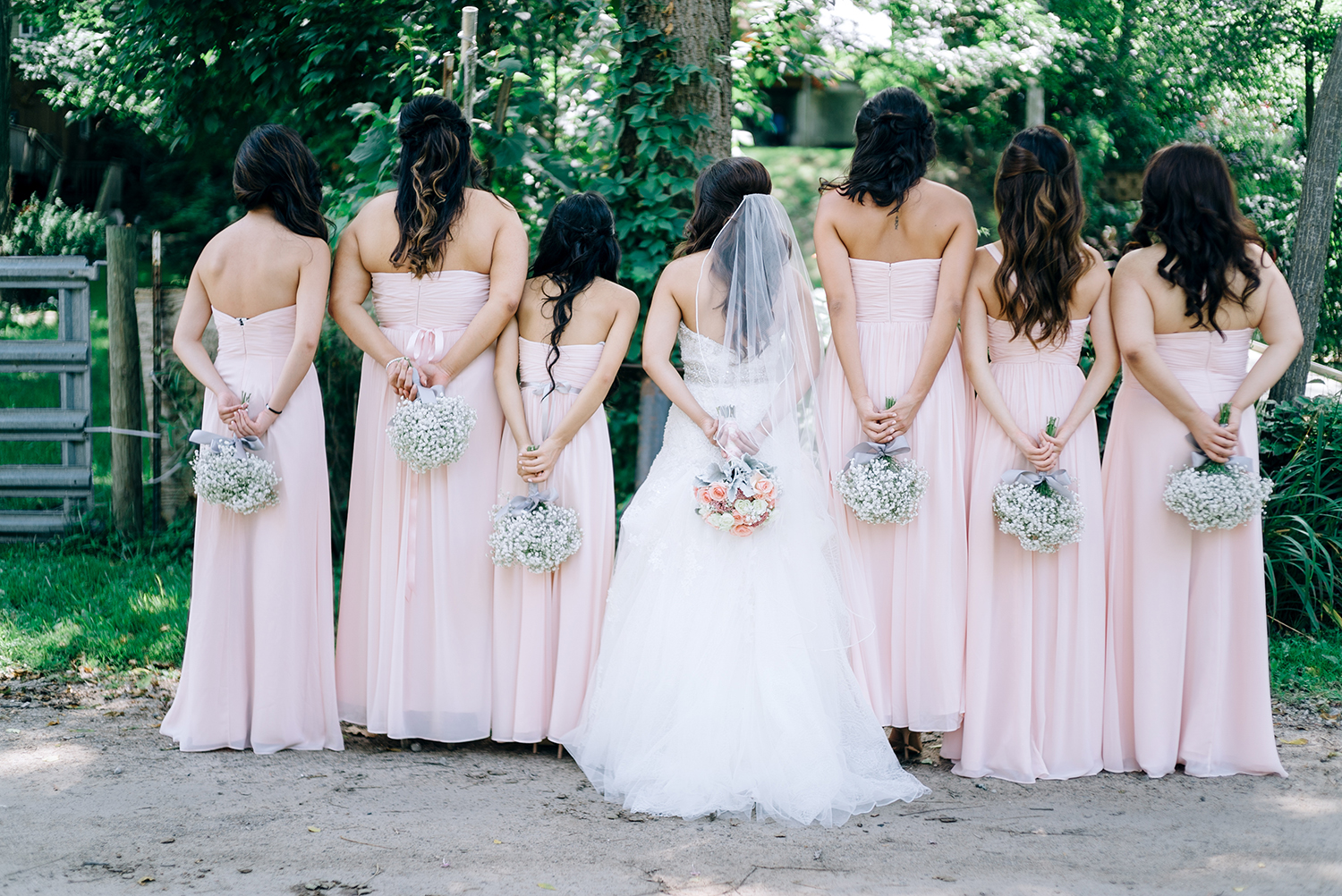 bride and bridesmaids with romantic wedding bouquets