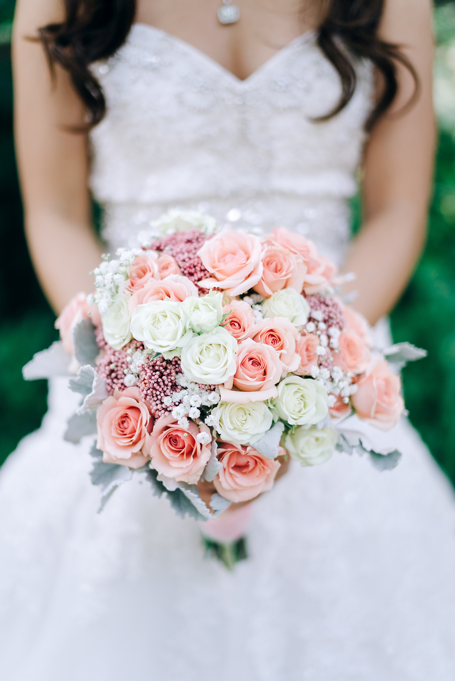 bride with soft pink rose wedding bouquet