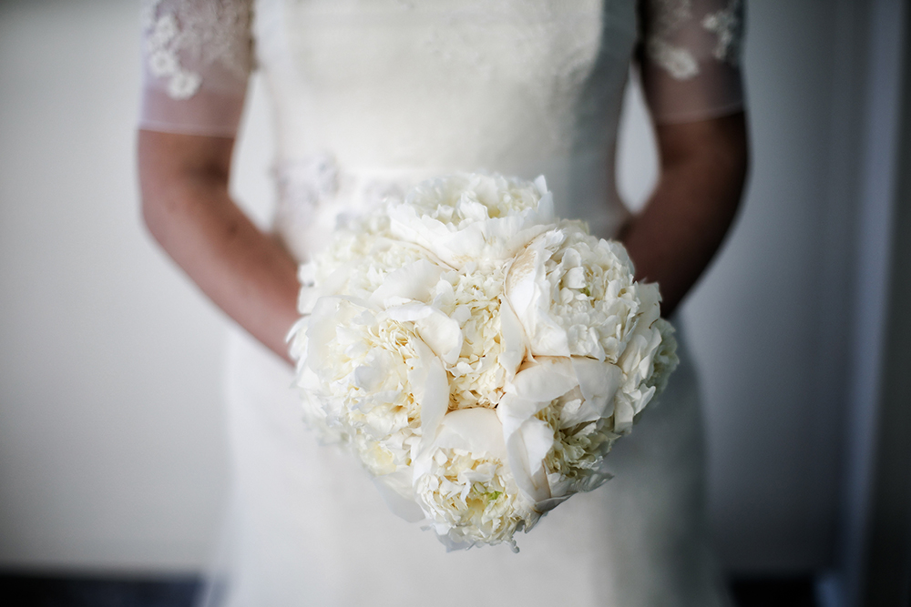 bride and her white peonies wedding bouquet
