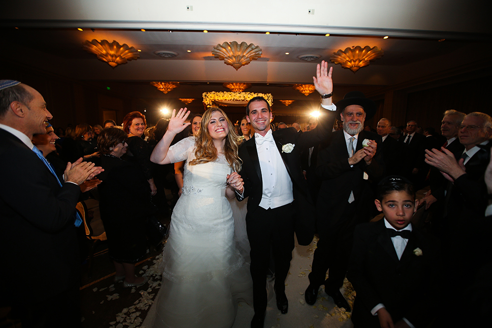 bride and groom just married enter reception