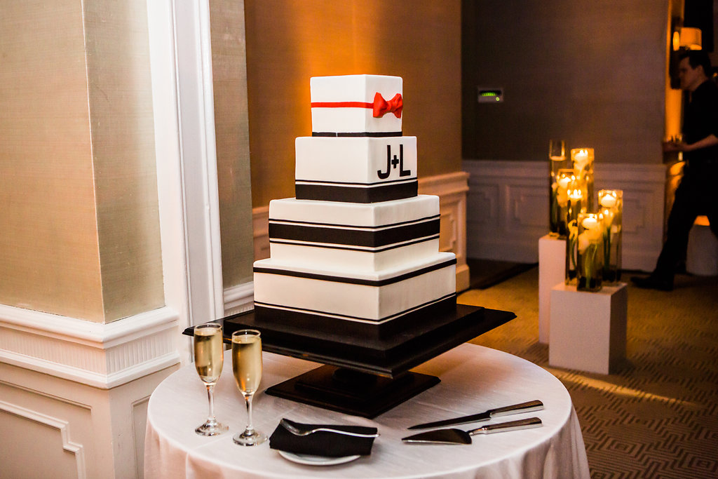 elegant wedding cake with red bow tie