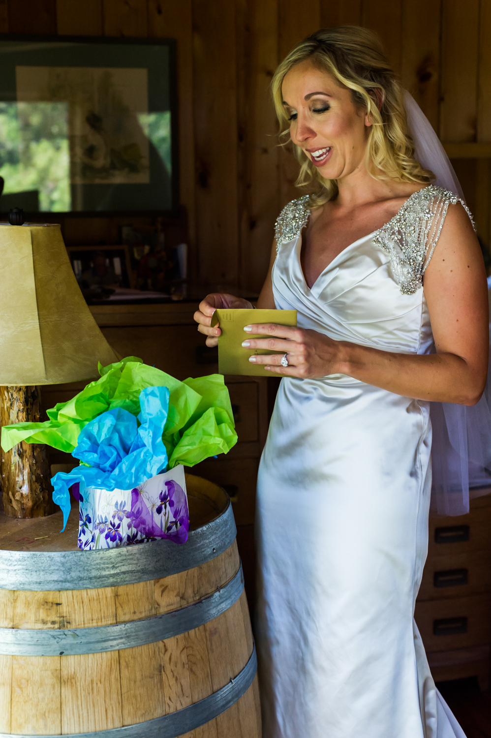 BridalPulse - An Outdoor Vineyard Wedding in NC By Rent My Wedding | bride opening gift from groom