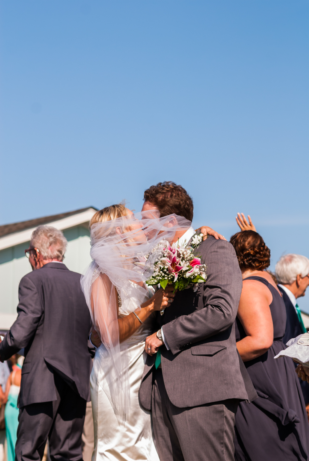 BridalPulse - An Outdoor Vineyard Wedding in NC By Rent My Wedding | bride and groom kiss in north carolina wedding