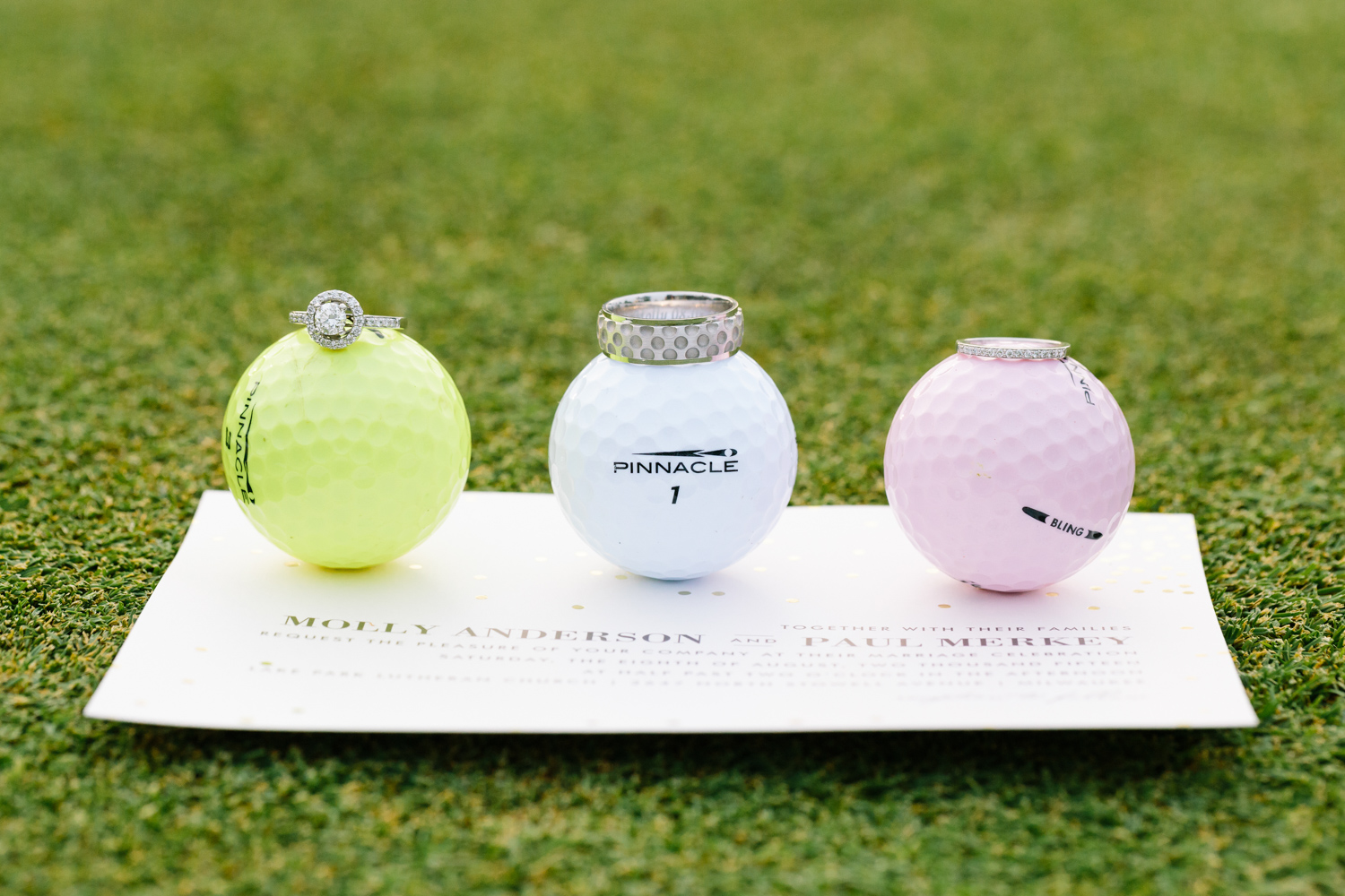 golf lovers country club wedding - engagement and wedding rings on golf balls