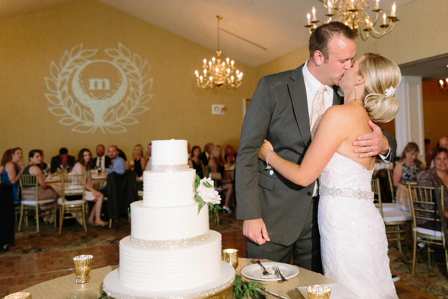 BridalPulse - Golf Lovers' Country Club Wedding - bride and groom wedding cake and monogram lighting on wall