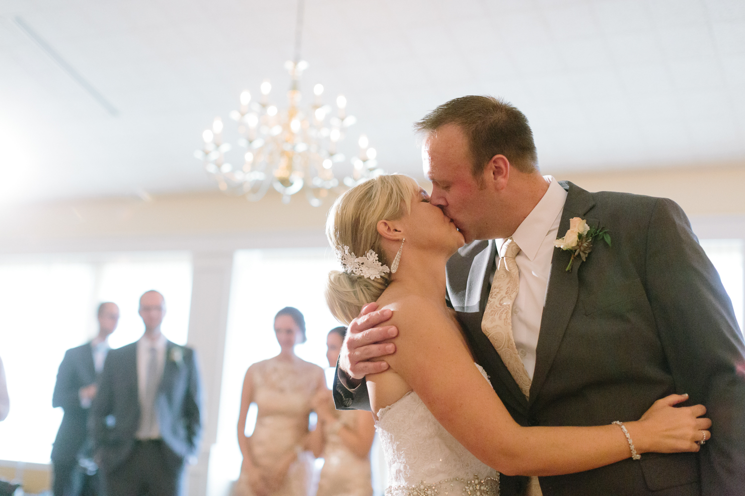 BridalPulse - Golf Lovers' Country Club Wedding - bride and groom kiss at wedding reception