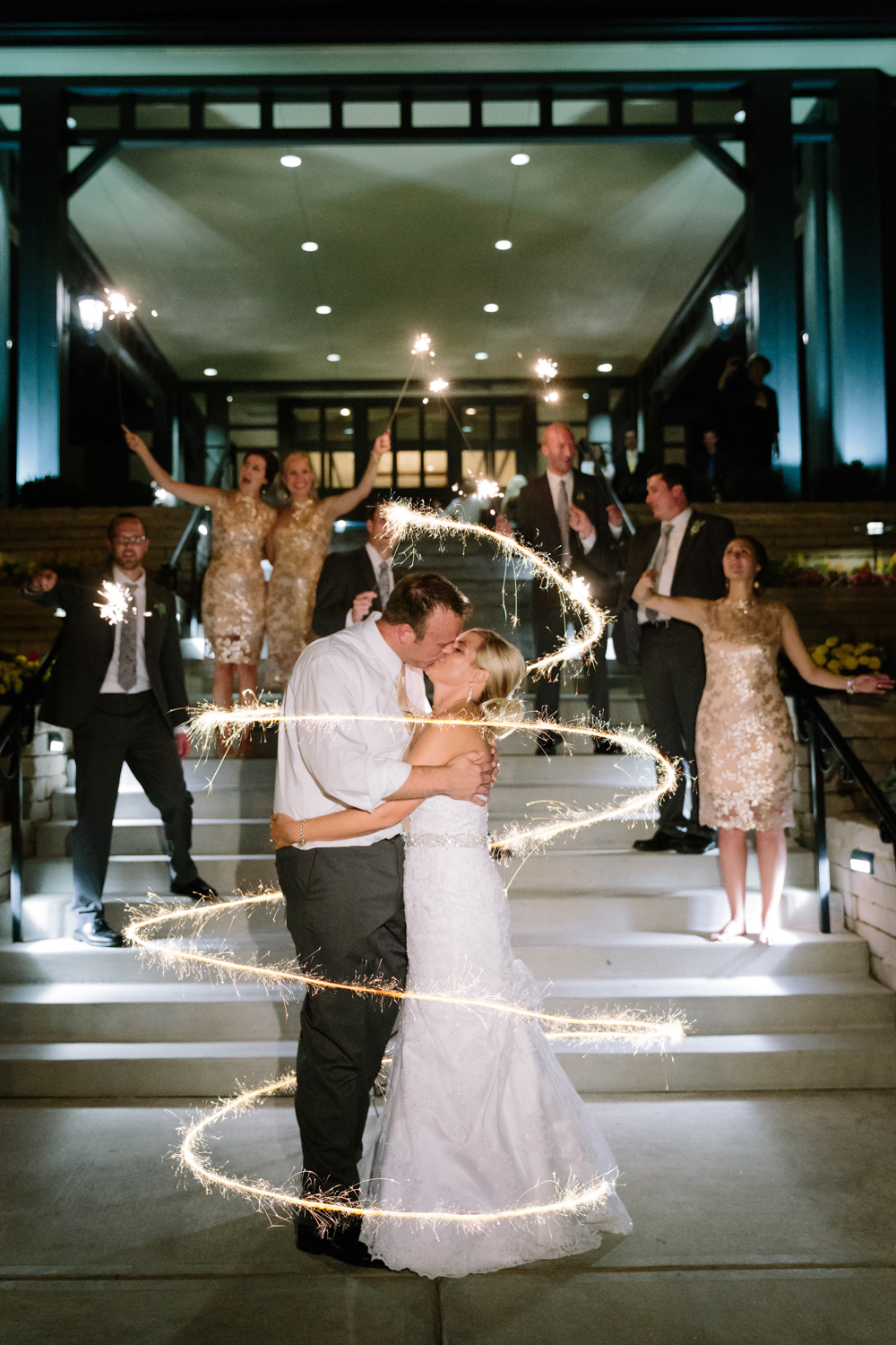 BridalPulse - Golf Lovers' Country Club Wedding - bride and groom kiss with sparklers surrounding them