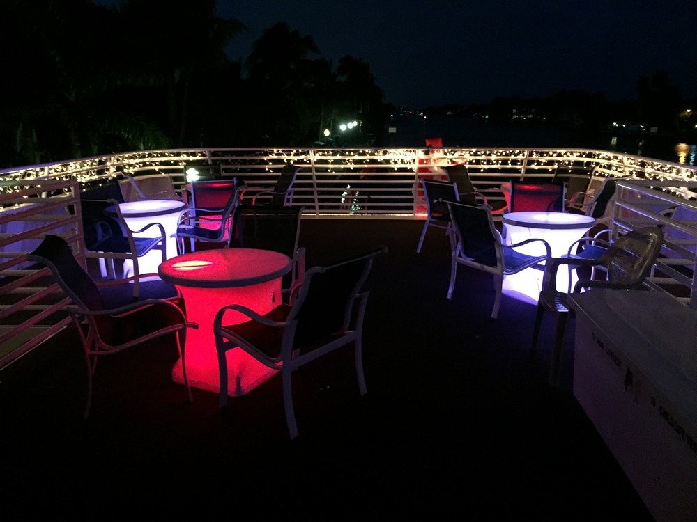 BridalPulse - How to Create Uplighting for Your Wedding - Table Glow effects on a balcony for an outdoor wedding- Photography by Rent My Wedding