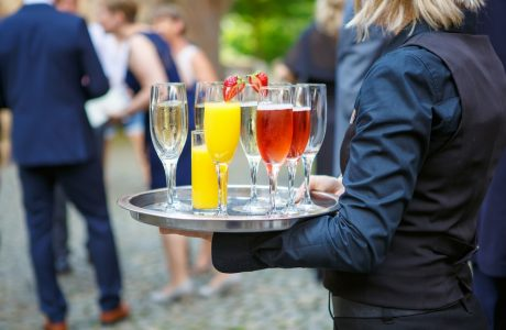 BridalPulse - Why You Should Hire Professional Bartending Staff for Your Wedding Reception by Liqs - cocktail server holding a drinks tray at a wedding