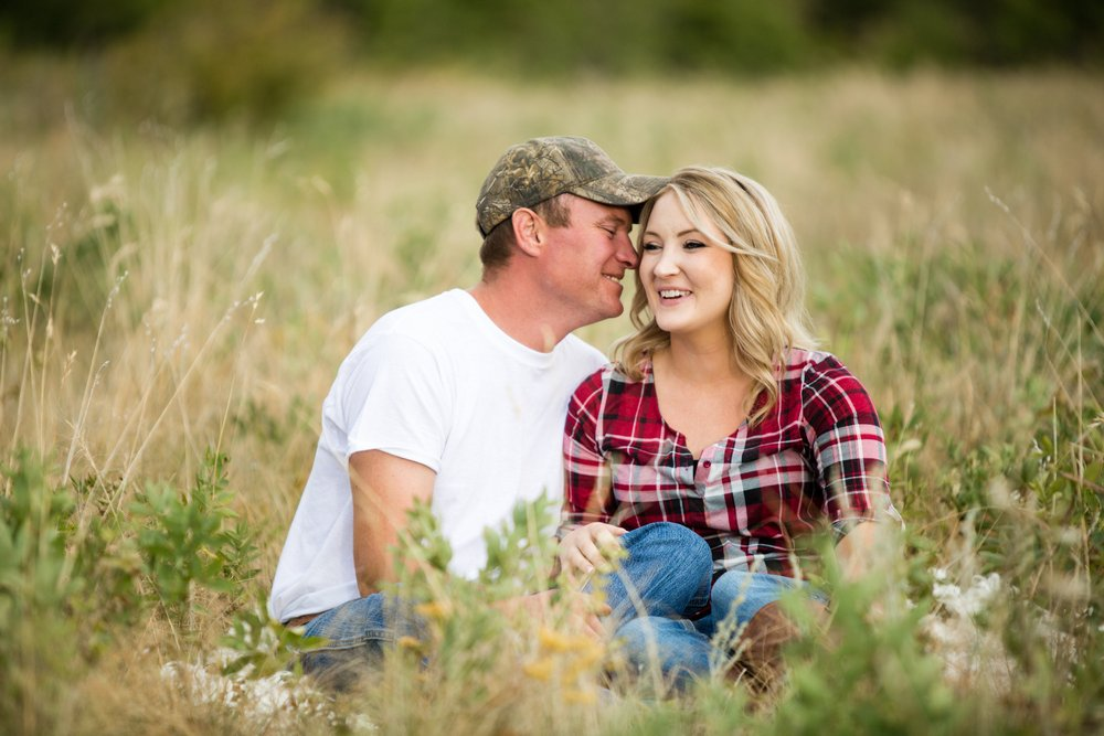 BridalPulse - Rustic and Romantic Colorado Engagement Shoot-Photography by Haley Allen Photography- The couple relax on a blanket in a field