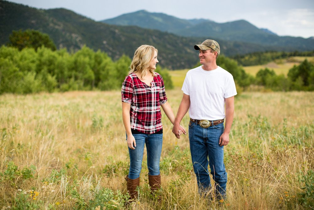 BridalPulse - Rustic and Romantic Colorado Engagement Shoot-Photography by Haley Allen Photography- engaged couple standing in a field smiling
