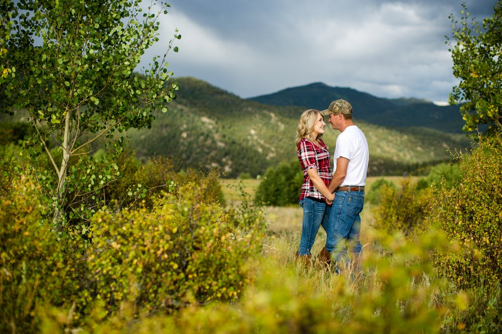 BridalPulse - Rustic and Romantic Colorado Engagement Shoot-Photography by Haley Allen Photography- engaged couple talking closely