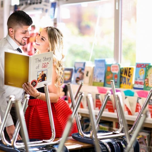 BridalPulse - School Daze Engagement Shoot in Southern California - The reads a book to each other in the school's library- Photography by George Street Photography