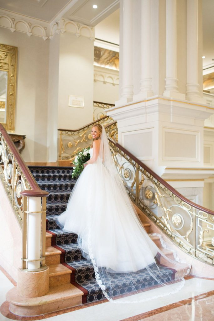 wedding planning tips and inspiration: wedding gown back view, bride on stairs