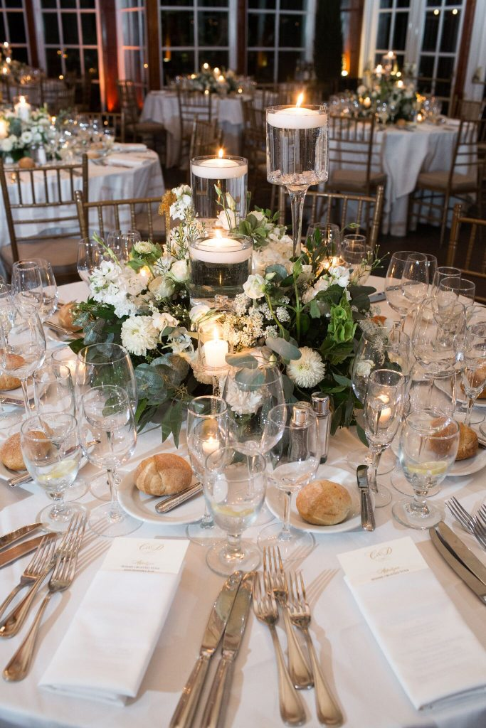 wedding planning tips and inspiration: centerpieces and flowers at a boathouse central park nyc wedding